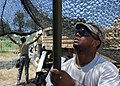 U.S. Soldiers assigned to the 172nd Chemical Company at Fort Riley, Kan., prepare netting at the Displaced Civilian Relocated Civilian exercise area during exercise Vibrant Response 13 at Camp Atterbury, Ind 120801-F-HS649-172.jpg