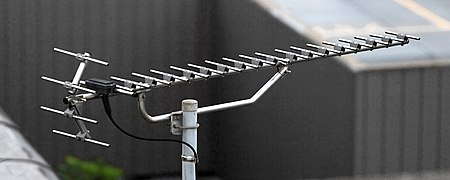 A modern high gain UHF Yagi television antenna. It has 17 directors, and one reflector (made of 4 rods) shaped as a corner reflector. UHF TV Antenna 001.JPG