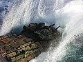 US Navy 020323-N-9855D-002 USMC AAV leaves LPD-10's well deck.jpg