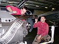 US Navy 030210-N-0683J-032 Aviation Ordnancemen preventive maintenance on a M-61A1 Vulcan 20 mm machine gun in the ship's hangar bay.jpg