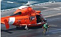 US Navy 030226-N-4655M-004 Flight deck personnel aboard USS Constellation (CV 64) remove wheel chocks and tie-down chains during the launch of a HH-65A Dolphin search and rescue helicopter.jpg