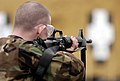 US Navy 030317-N-9693M-002 Master-at-Arms Seaman James Mills takes aim at a target during an M-16 rifle qualification course.jpg