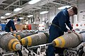 US Navy 030320-N-5292M-002 Aviation Ordnancemen inspect a Joint Direct Attack Munition (JDAM) GBU-31 in preparation for loading on air wing aircraft.jpg