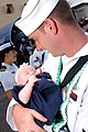 US Navy 030728-N-3994W-012 A new father meets his three-week-old daughter for the first time following the return of his ship, the Arleigh Burke-class destroyer USS O'Kane (DDG 77).jpg