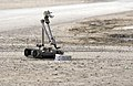 US Navy 041103-N-4614W-033 A U.S. Army explosive ordnance disposal (EOD) robot, i-Robot, pulls the wire of an alleged improvised explosive device (IED), found by the Iraqi Police.jpg