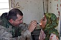 US Navy 041112-M-0095Z-051 U.S. Navy Chief Jeffrey Cavallo examines a 13-year-old Iraqi child during a Humanitarian Assistance Operation (HOA) in the village of Ash Shafiyah, Iraq.jpg