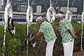 US Navy 041207-N-3207B-077 Al Rodrigues, left, a Pearl Harbor survivor, places a wreath on the USS West Virginia memorial during the 63rd Commemoration of the Dec. 7, 1941 attack on Pearl Harbor, Hawaii.jpg