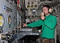 US Navy 050121-N-4336M-083 Aviation Boatswain's Mate 2nd Class Jeffrey B. Hartman runs the controls for a steam-powered catapult as he communicates with a phone talker on the flight deck aboard the Nimitz-class aircraft carrier.jpg