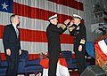 US Navy 050218-N-5920N-021 Admiral William J. Fallon, left, and Admiral John B. Nathman, right, render hand salutes signifying the official turnover of duties and responsibilities.jpg