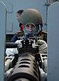 US Navy 050218-N-9703H-013 Disbursing Clerk 3rd Class John Gellineau mans a .50 caliber machine gun mount during a Strike Group Force Protection exercise aboard the Nimitz-class aircraft carrier USS Carl Vinson (CVN 70).jpg