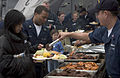 US Navy 050531-N-9851B-017 Culinary Specialist 2nd Class Joel Siron serves food to crew members and quests aboard the Arleigh Burke-class guided missile destroyer USS John S. McCain (DDG 56).jpg