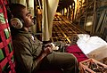 US Navy 050904-C-2023P-501 Coast Guard Petty Officer 2nd Class Miguel Martinez takes a couple of moments to relax.jpg