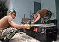 US Navy 060702-N-3714J-036 U.S. Navy Seabees assigned to Naval Mobile Construction Battalion Four Zero (NMCB-40), build cabinets for the Chittagong Medical and College Facility.jpg