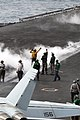 US Navy 060829-N-7526R-030 Aircraft handlers direct aircraft to the number two catapult aboard the Nimitz-class aircraft carrier USS Ronald Reagan (CVN 76), during flight operations.jpg