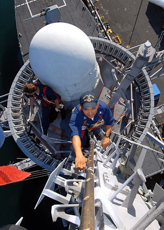 Maritime mobile-satellite service - Image: US Navy 070124 N 4965F 004 Electronics Technician 2nd Class Joseph Melchor, assigned to the Arleigh Burke class guided missile destroyer USS Paul Hamilton (DDG 60), climbs the mast of the Paul Hamilton to perform pre deployment