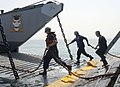 US Navy 070507-N-7095C-001 Sailors work to accomplish a stern gate marriage between a landing craft unit (LCU) and amphibious transport dock USS Shreveport (LPD 12).jpg