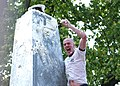 US Navy 070517-N-8395K-003 Midshipman 4th Class Jamie Schrock celebrates victory at the U.S. Naval Academy's annual Herndon Climb.jpg