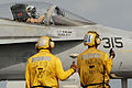 US Navy 070521-N-2659P-010 Aviation Boatswain's Mate 2nd Class Cordon Minor, left, and Aviation Boatswain's Mate Airman Andrew Runge give thumbs up to the pilot of an F-A-18C.jpg
