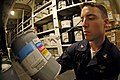 US Navy 070913-N-7883G-016 Aviation Support Equipment Technician 3rd Class Aaron Meyer inventories heat transfer fluid containers in USS Kitty Hawk's (CV 63) forward hazardous materials storeroom.jpg
