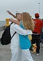 US Navy 080703-N-6410J-056 A Sailor assigned to the frigate USS Vandegrift (FFG 48) kisses his wife after returning home from a deployment.jpg
