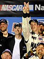 US Navy 080822-N-5345W-259 JR Motorsports co-owner Dale Earnhardt, Jr. celebrates with driver Brad Keselowski and the rest of the No. 88 U.S. Navy Chevrolet Monte Carlo team.jpg