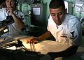 US Navy 080918-N-6764G-017 Quartermaster 3rd Class Steven Herrera plots a course aboard the amphibious transport dock ship USS San Antonio (LPD 17) before a port visit to Marmaris, Turkey.jpg