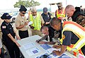 US Navy 090325-N-3666S-107 Personnel assigned to Naval Station Pearl Harbor review a map of the affected area during a chemical, biological, radiological, nuclear and explosive exercise on historic Ford Island.jpg