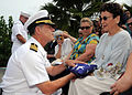 US Navy 090408-N-9758L-087 Capt. Douglas Waite, command chaplain for commander, Navy Region Hawaii and Naval Surface Group Middle Pacific, hands a folded American flag to the wife of Pearl Harbor survivor retired Capt. Demetriu.jpg