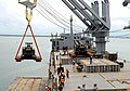US Navy 090608-N-5787K-001 A 154,000-pound Manitowoc crane is lifted off the deck of the Military Sealift Command crane ship SS Cornhusker State (T-ACS 6).jpg