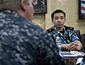 US Navy 090614-F-7923S-006 Capt. James J. Ware, left, commanding officer of the medical treatment facility aboard the Military Sealift Command hospital ship USNS Comfort (T-AH 20), speaks with a group of Chinese medical observe.jpg