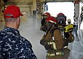 US Navy 090713-N-1324F-003 Members of a hose team fight a simulated fire during a general quarters drill aboard the aircraft carrier USS Enterprise (CVN-69).jpg
