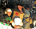 US Navy 090909-N-4010S-069 Marines work with Indonesian military personnel to load a CH-53E Super Stallion helicopter with relief supplies for victims of recent earthquakes and resulting landslides.jpg