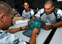US Navy 100530-N-2798F-011 Aviation Ordnanceman Airman Justin Stout and Aviation Electronics Technician Airman Anthony Bertolino spend their break playing the game Battleship aboard the Nimitz-class aircraft carrier USS Harry S