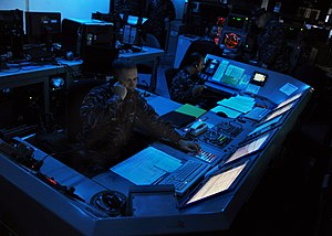 Military operations other than war - US Navy officers aboard the aircraft carrier USS ''Abraham Lincoln'' (CVN 72) monitor defense systems during maritime security operations.