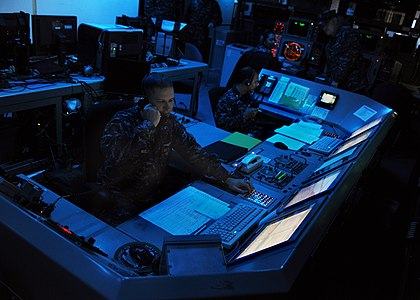 US Navy 100913-N-4973M-012 Lt. j.g. Craig Mueller, from St. Louis, Mo., and Lt. j.g. Zach Decker, from Boulder, Co., monitor the defense systems ab