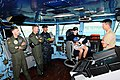 US Navy 100927-N-1276B-158 Linus Phillips asks Capt. Paul M. Monger questions during a scheduled tour.jpg