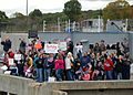 US Navy 101015-N-3090M-050 Friends and family of Sailors aboard the Los Angeles-class attack submarine USS Pittsburgh (SSN 720) welcome home loved.jpg