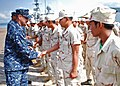 US Navy 102610-N-8539M-473 Chief Damage Controlman Saul Delacruz leads a team of U.S. Sailors as they meet Cambodian sailors before boarding a Roya.jpg