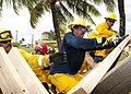 US Navy 110121-N-3570S-110 Fire and emergency services firefighters assigned to U.S. Naval Base Guam (NBG) construct emergency shoring from pieces.jpg