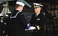 US Navy 110502-N-OI955-154 Cmdr. Stevin Johnson passes the flag to Religious Programs Specialist 3rd Class Daniel Graham during a burial at sea cer.jpg