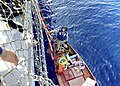 US Navy 110913-N-VH839-026 Fire Controlman 3rd Class Matthew Burger, a visit, board, search and seizure (VBSS) first climber aboard the Arleigh Bur.jpg