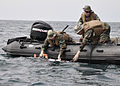 US Navy 110913-N-XX999-002 Mineman 1st Class Matthew Giannini, left, Mineman Seaman Ryan Scott Barina, and Electronics Technician 2nd Class James B.jpg
