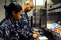 US Navy 111006-N-HM829-018 Hospital Corpsman 1st Class Paul A. Duncan, right, and Hospital Corpsman 3rd Class Jessica A. Hooks count medication.jpg