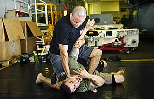 US Navy 120102-N-GC412-128 Sailors practice mixed martial arts in the hangar bay.jpg
