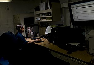 US Navy 120103-N-TZ605-009 Information Systems Technician 2nd Class Toccara Henry, assigned to the combat systems department aboard the Nimitz-clas.jpg