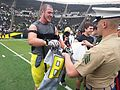 University of Oregon players exchange game jerseys 140503-Z-TK422-0336.jpg
