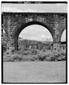 VIEW OF A STONE ARCH, FRONT, OHIO SIDE - Baltimore and Ohio Railroad, Benwood Bridge, Benwood, Marshall County, WV HAER WVA,26-BEN,1-6.tif