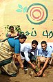Vikram and Information Officer Anand Krishna plant a sapling at the YMCA grounds 1.jpg