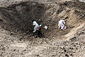 Villagers search for scrap metal after a controlled detonation at the demolition range at Forward Operating Base Salerno in Khost province, Afghanistan, Sept 120902-A-PO167-143.jpg