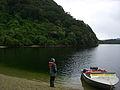 Wairaurahiri Jetboat parked on beach of Lake Hauroko.jpg